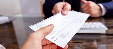 Chèques: Légère hausse des incidents de paiement en 2020